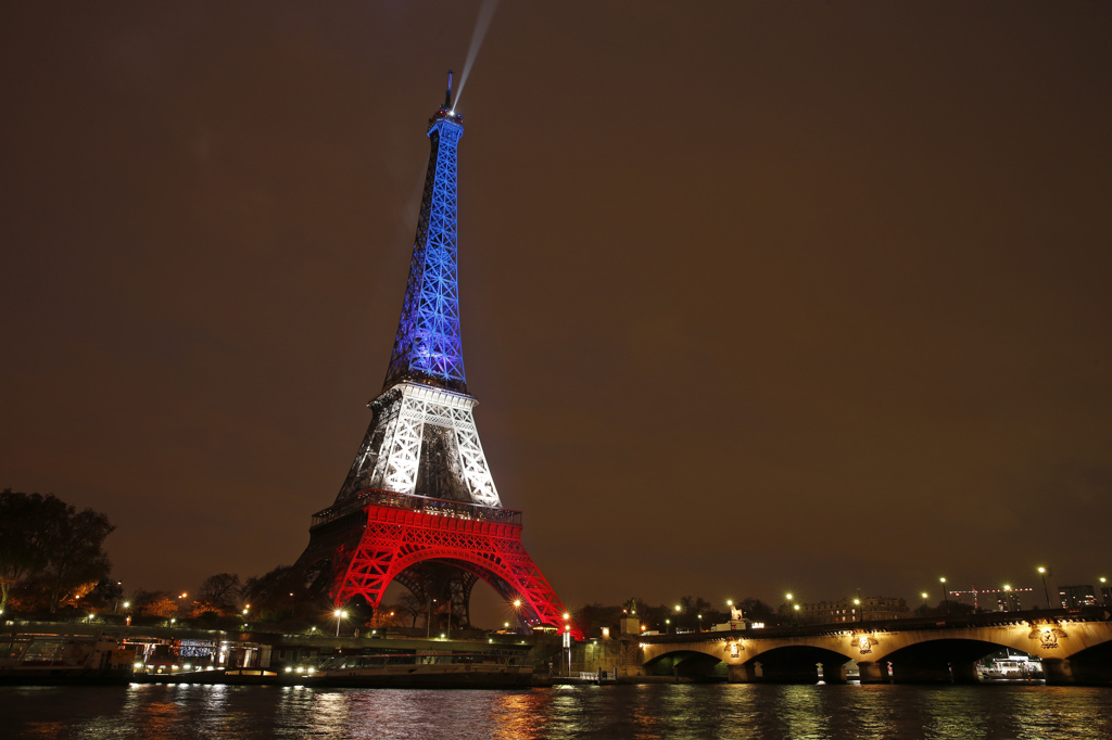 The Eiffel Tower is lit with the blue, white and red colours of the French flag in Paris, France, November 16, 2015, to pay tribute to the victims of a series of deadly attacks on Friday in the French capital.  REUTERS/Benoit Tessier   TPX IMAGES OF THE DAY  - RTS7EHJ